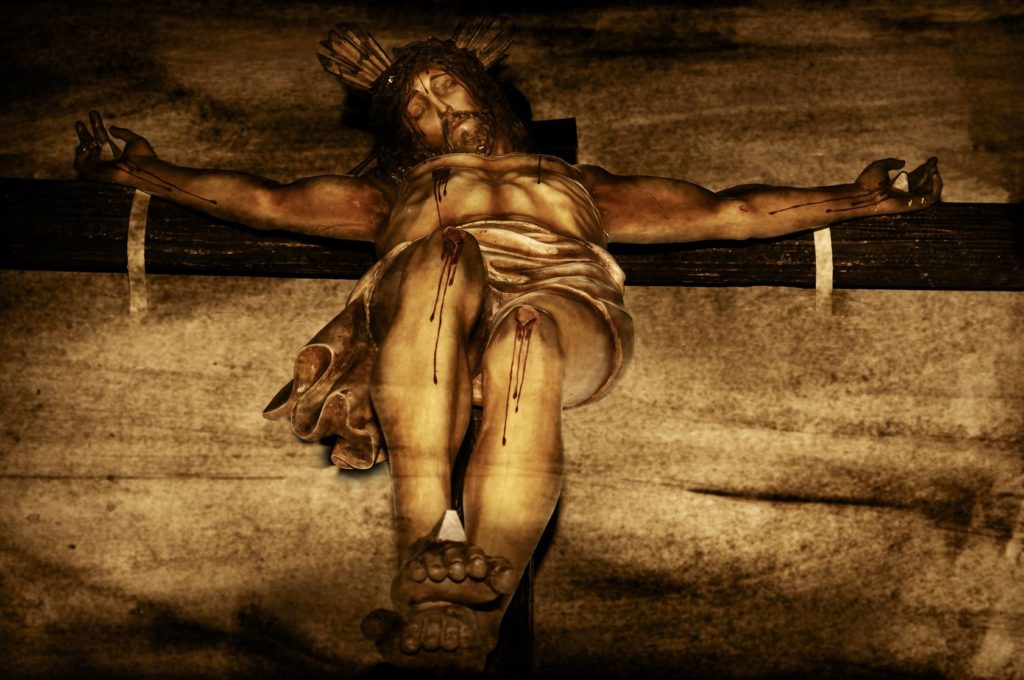 18176512 - jesus christ on the holy cross on a vintage background